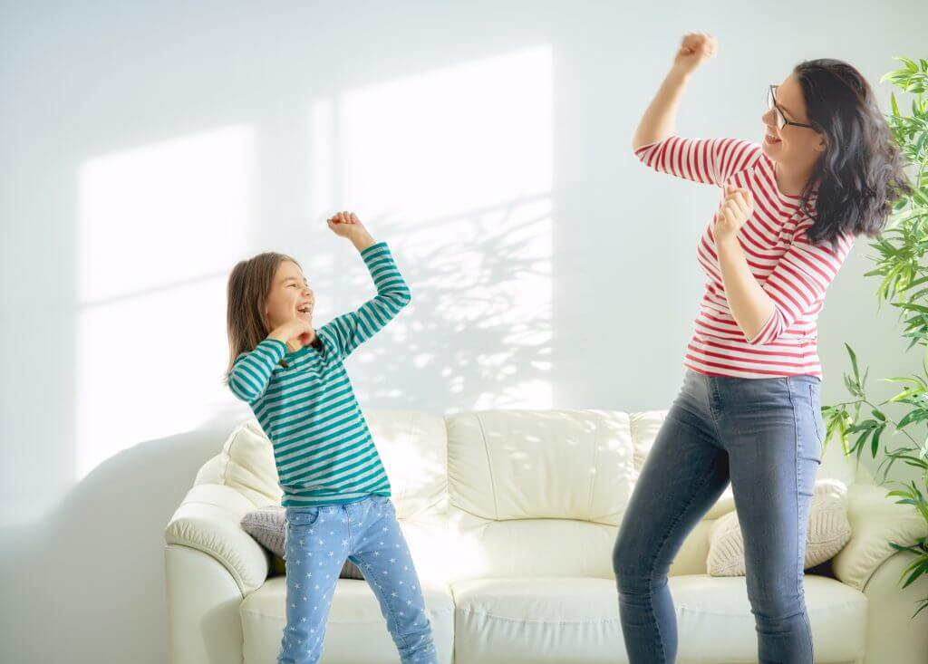 Happy loving family. Mother and her daughter child girl playing and dancing together